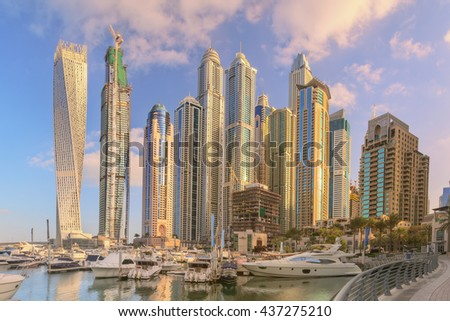 Panoramic view of Dubai Marina bay with yacht and cloudy sky, Dubai, UAE