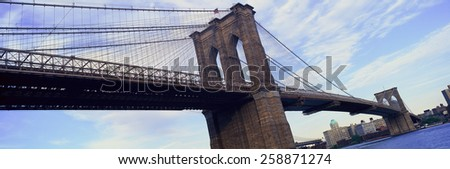 Panoramic view of East River and Brooklyn Bridge to lower Manhattan, New York City, NY - stock photo