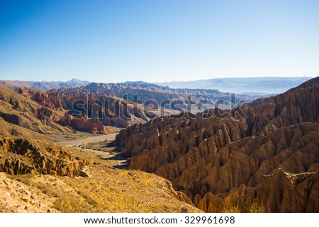 Panoramic view of eroded mountain range and canyons around Tupiza. From here start the outstanding 4 days road trip to Uyuni Salt Flat, among the most important travel destination in Bolivia.