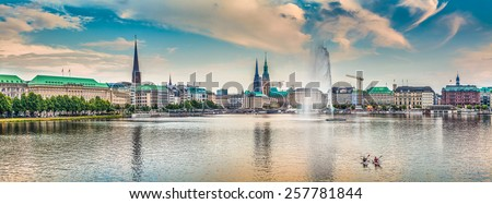 Panoramic view of famous Binnenalster (Inner Alster Lake) in golden evening light at sunset, Hamburg, Germany - stock photo