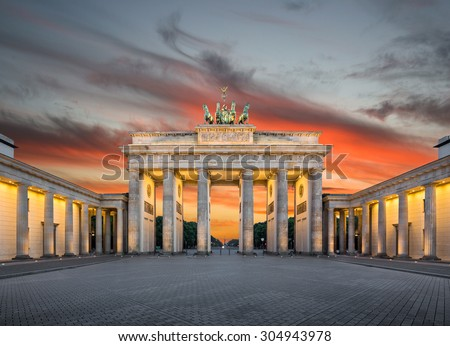 Panoramic view of famous Brandenburger Tor (Brandenburg Gate), one of the best-known landmarks and national symbols of Germany, in beautiful evening light at sunset, Pariser Platz, Berlin, Germany - stock photo