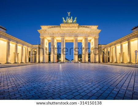 Panoramic view of famous Brandenburger Tor (Brandenburg Gate), one of the best-known landmarks and national symbols of Germany, in twilight during blue hour at dawn, Berlin, Germany - stock photo