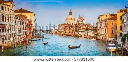 Panoramic view of famous Canal Grande and Basilica di Santa Maria della Salute at sunset in Venice, Italy - stock photo