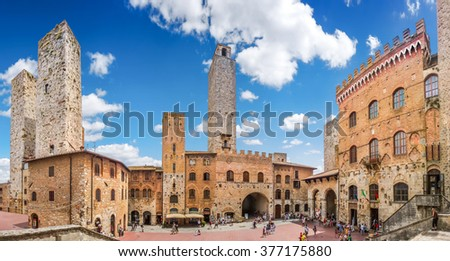 Panoramic view of famous Piazza del Duomo in the historic town of  San Gimignano on a sunny day, Tuscany, Italy - stock photo