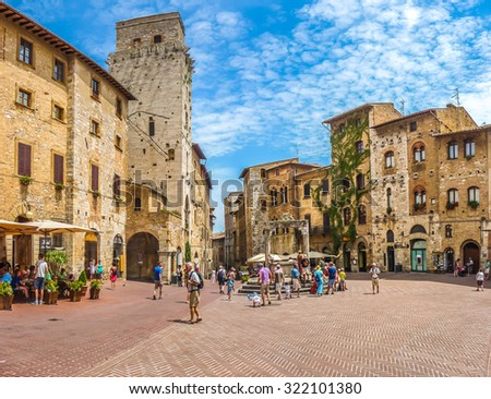 Panoramic view of famous Piazza della Cisterna in the historic town of San Gimignano on a sunny day, Tuscany, Italy - stock photo