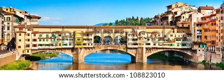 Panoramic view of famous Ponte Vecchio with river Arno at sunset in Florence, Italy - stock photo
