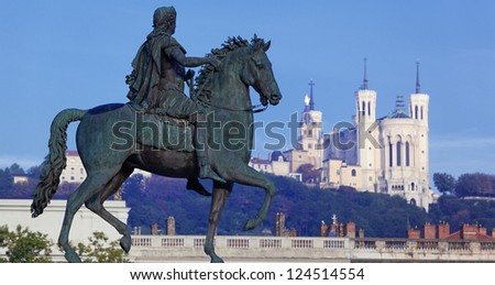 panoramic view of famous statue and Fourviere basilic on a background - stock photo