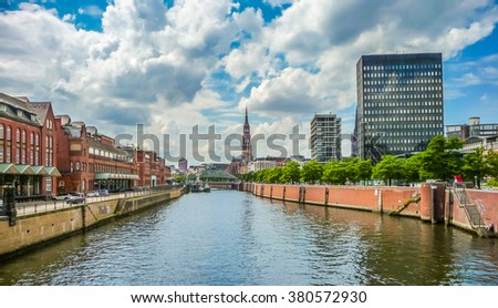 Panoramic view of famous Zollkanal with the historic St. Catherine's Church (Katharinenkirche), and old bridge in the Speicherstadt warehouse district of Hamburg, Germany