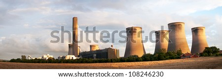 Panoramic view of Fiddler's Ferry coal burning power station, England. Cooling towers in the evening light with a field of wheat in the foreground - stock photo