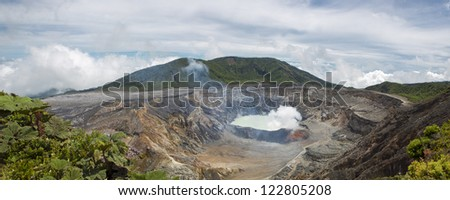 Panoramic view of  fumarole smoke over the Poas Volcano in Costa Rica in 2012. Detail of the acid water crater with turquoise colors. - stock photo
