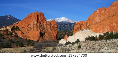 Panoramic view of Garden of the Gods in Colorado Springs - red sandstone formations with Pikes Peak in background. - stock photo