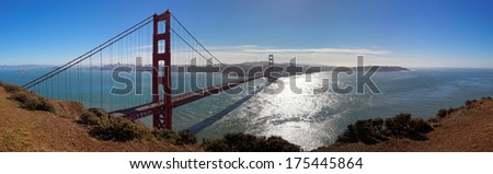 Panoramic View of Golden Gate bridge against midday sun, California, USA - stock photo