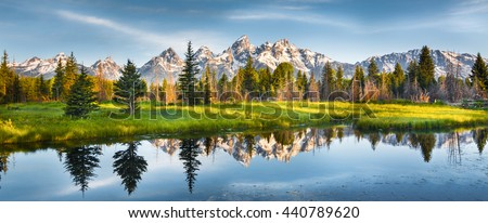 Panoramic view of Grand Teton range in Grand Teton National Park. Grand Teton National Park is in Wyoming, USA. Also, Grand Teton range is a range of mountains part of the US Rockies. - stock photo