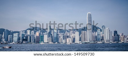 Panoramic view of Hong Kong city with Victoria harbor as a foreground. - stock photo