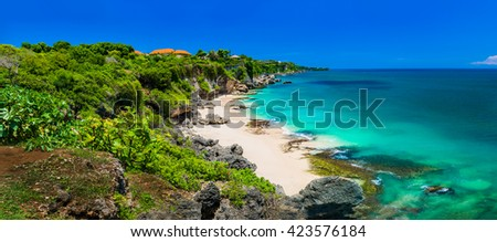 Panoramic view of iidyllic tropical beach with yellow sand and perfect azure clean water / Indonesia, Bali - stock photo