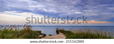Panoramic view of Lake Ontario at sunset from edge of Scarborough Bluffs, Ontario, Canada. - stock photo
