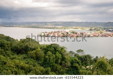 Panoramic view of  Lake Peten Itza and the colonial town of Flores in the north of Guatemala. Central America