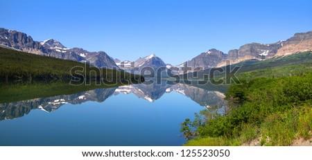 Panoramic view of Lake Sherburne in Glacier national park - stock photo