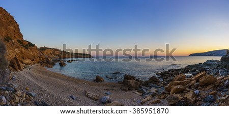 Panoramic view of Legrena beach in Attica - Greece. It is found along the coastal road that leads to Cape Sounion and the long beach stretches for many meters surrounded by a protected cove with rocks - stock photo