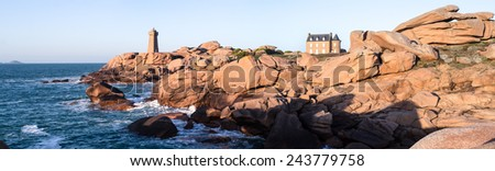 Panoramic view of Lighthouse and iconic shaped rocks on the Pink Granite Coast in Brittany in the northwest part of France. - stock photo