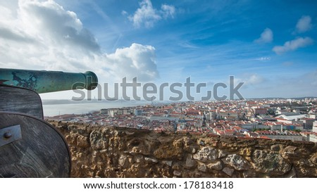 """Panoramic view of Lisbon city and Tagus river from the """"Castle Sao Jorge"""" with cannon in the foreground. Lisbon, Portugal. - stock photo"""