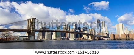 Panoramic view of Manhattan skyline and Brooklyn Bridge, New York City - stock photo