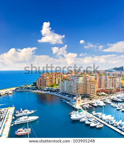 panoramic view of marina with beautiful blue sky. Fontvieille, new district of Monaco, french riviera - stock photo