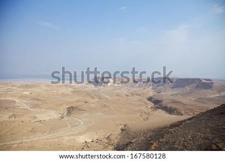 Panoramic view of Masada summit and Dead Sea in Judea Negev desert, Israel. - stock photo