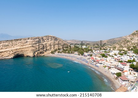 Panoramic view of Matala sandy beach with caves near Heraklion town on Crete, Greece. - stock photo