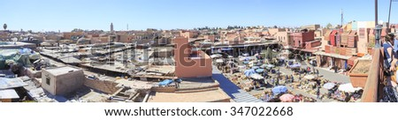 Panoramic view of medina and Local market in Marrakech, Morocco, March 20 2015.  - stock photo