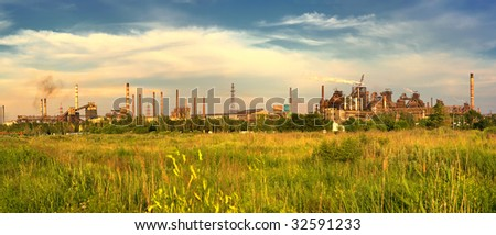 panoramic view of metallurgical works with smog - stock photo