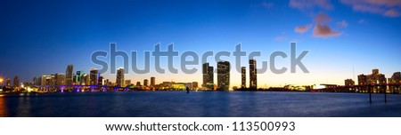 Panoramic view of Miami skyline and Biscayne Bay at dusk