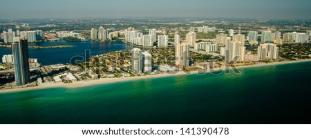 Panoramic view of Miami skyline showing waterfront and calm sea, Florida, U.S.A. - stock photo