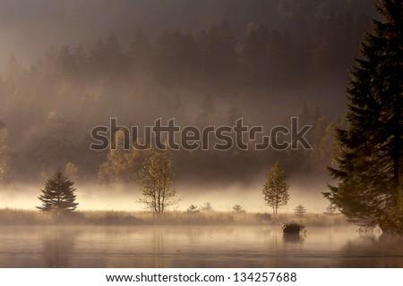 Panoramic view of middle range mountain lake in autumn, - stock photo
