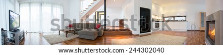 Panoramic view of modern interior with living room and kitchen - stock photo