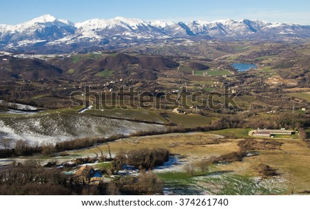 Panoramic view of Monti Sibillini National Park in the winter season with snow, Marche - Italy. - stock photo