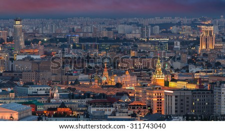 Panoramic view of Moscow - Kremlin towers, State general store, residential building at night - stock photo