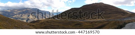 Panoramic view of mountain and road landscape in Queenstown district in South island of New Zealand - stock photo