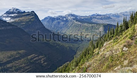 Panoramic View of Mountain Peaks in Glacier National Park, Montana.  Photo taken from Highline Trail. - stock photo
