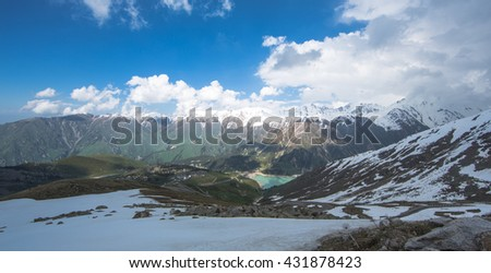 panoramic view of mountains and clouds