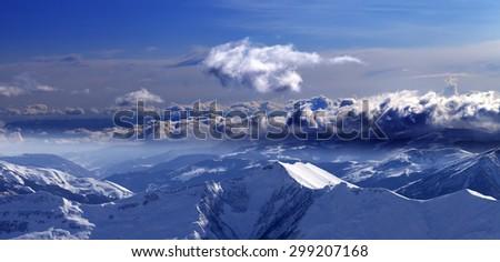 Panoramic view of mountains at evening and sunlight clouds. Caucasus Mountains, Georgia. Ski resort Gudauri. - stock photo