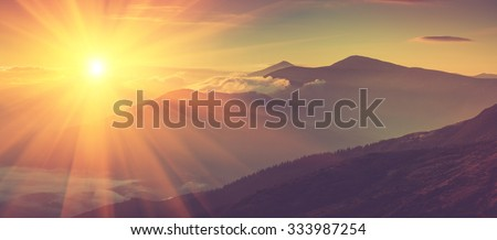 Panoramic view of mountains, autumn landscape with foggy hills at sunrise. Filtered image:cross processed vintage effect. - stock photo