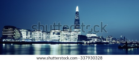 Panoramic view of new London city hall at night, special photographic processing. - stock photo