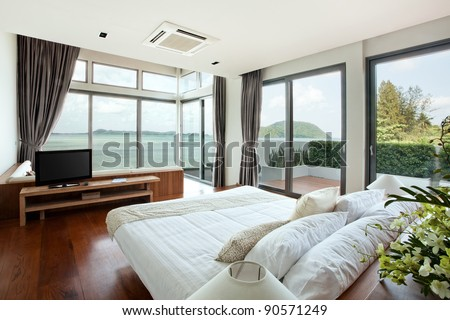panoramic view of nice cozy  bedroom  with  summer  outdoor. - stock photo
