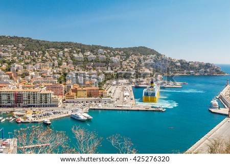 Panoramic view of Nice harbour with blue sky - stock photo