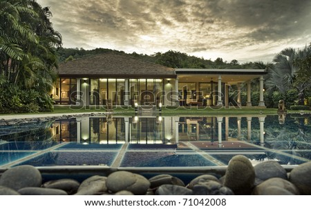 Panoramic view of nice tropic villa during sunset - stock photo