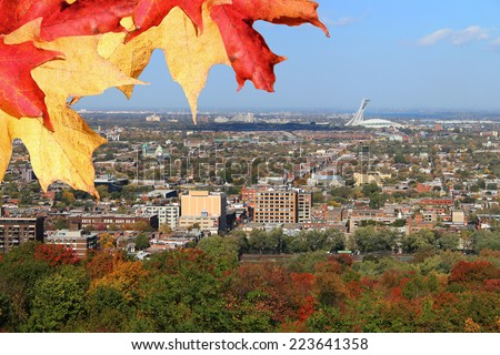 Panoramic view of North Montreal, Quebec, Canada during Autumn or Fall season  with colorful leaves and Olympic Stadium in the background  - stock photo