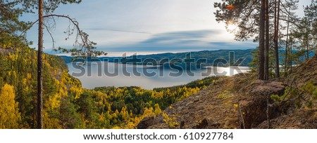 Panoramic view of norwegian fjord and autumn forests from above