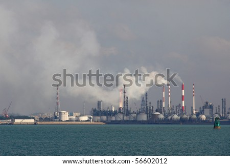 Panoramic view of oil refinery with the smoke emitting from the stack