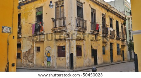 Panoramic view of Old havana crumbling building facade - stock photo